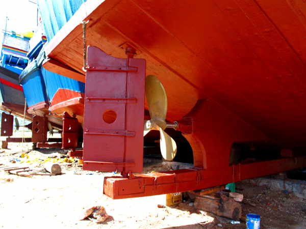 Stern details of three Ca Na MFVs including projecting lower transom frame timbers and rudders.