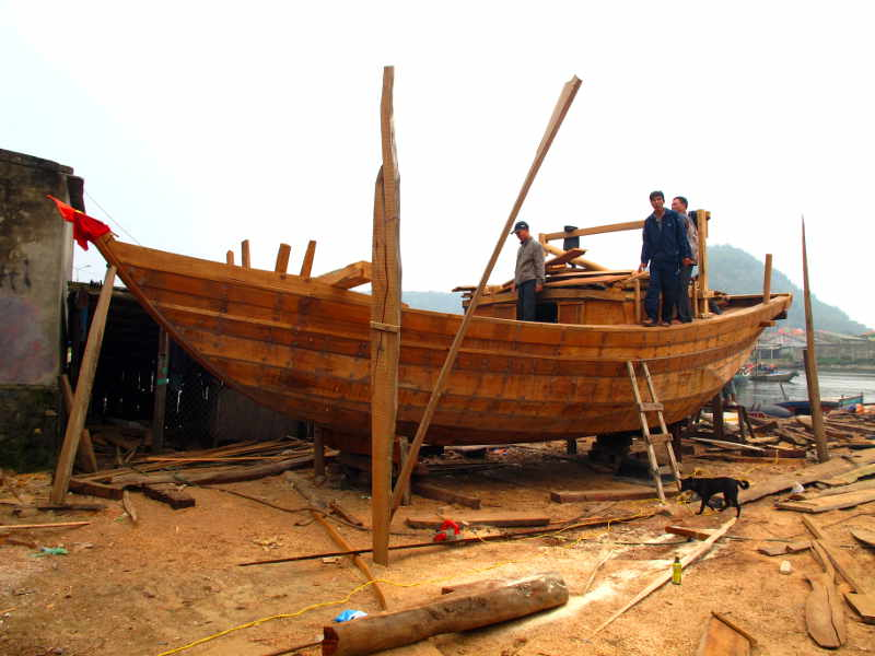 Cua Lo traditional boat under construction with top sides nearly complete.