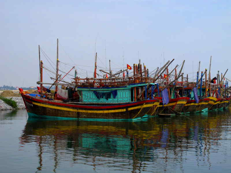 Modern Motor Fishing Boats in Ly Hoa: bright finished squid fishermen