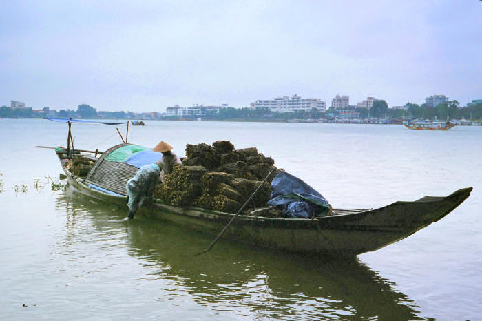 Traditional small boat on the Perfume River (Song Huong) at Hue