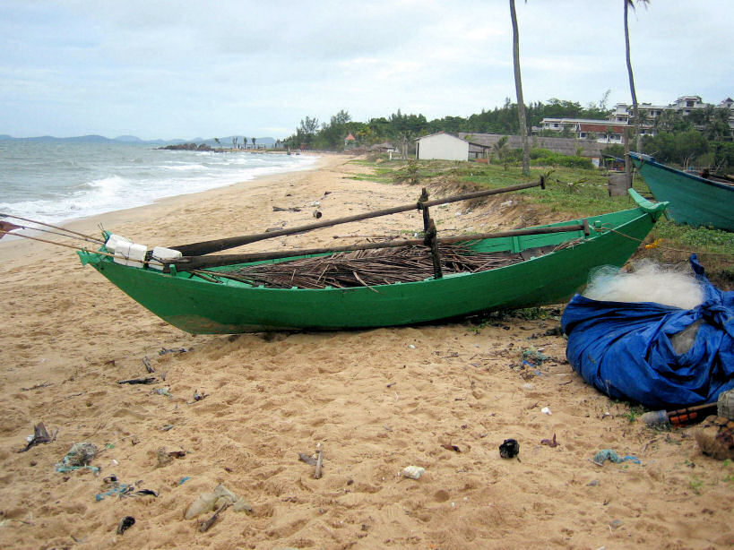 Small Green Traditional Row Boat on Beach Near Duong Dong