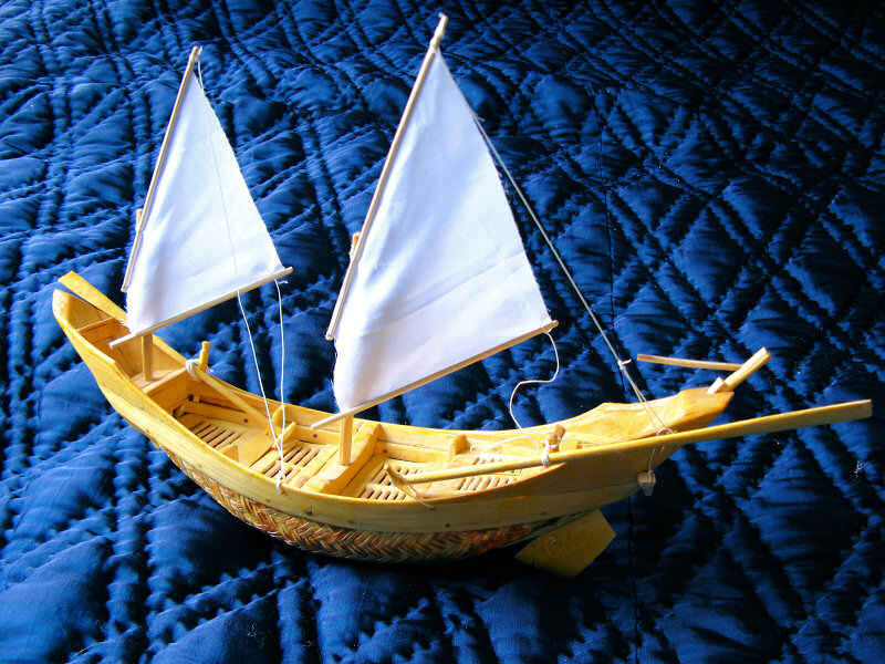Small model of a woven basket boat with sails and oars from Thuan An, Vietnam